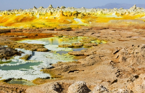 Volcano has left fields of spectacular salt-formations.