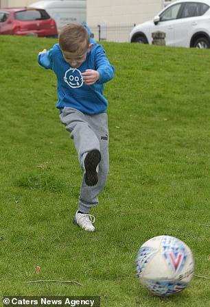 The youngster is back to playing football, however, his father worries about his future