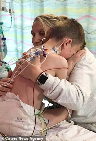 An emotional Tommy is seen being comforted by his mother as he recovers from his health scare