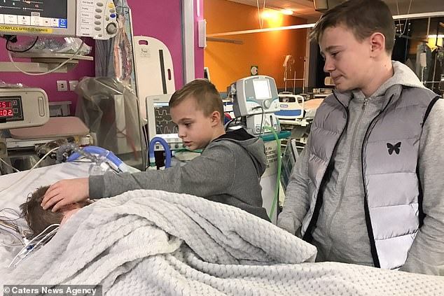Tommy's brothers Ben, 10, and Harry, 14, are pictured visiting him in hospital. The siblings - along with their brotherGeorge, 17 - watched on in horror as Tommy stopped breathing