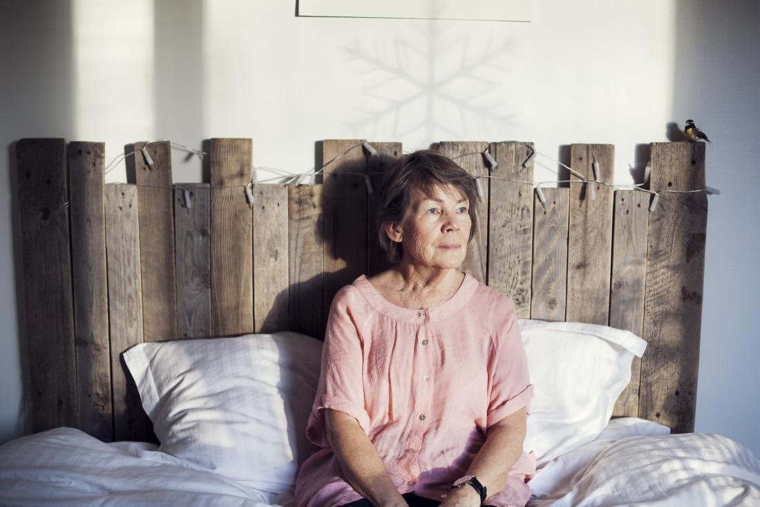 a senior woman sitting in bed