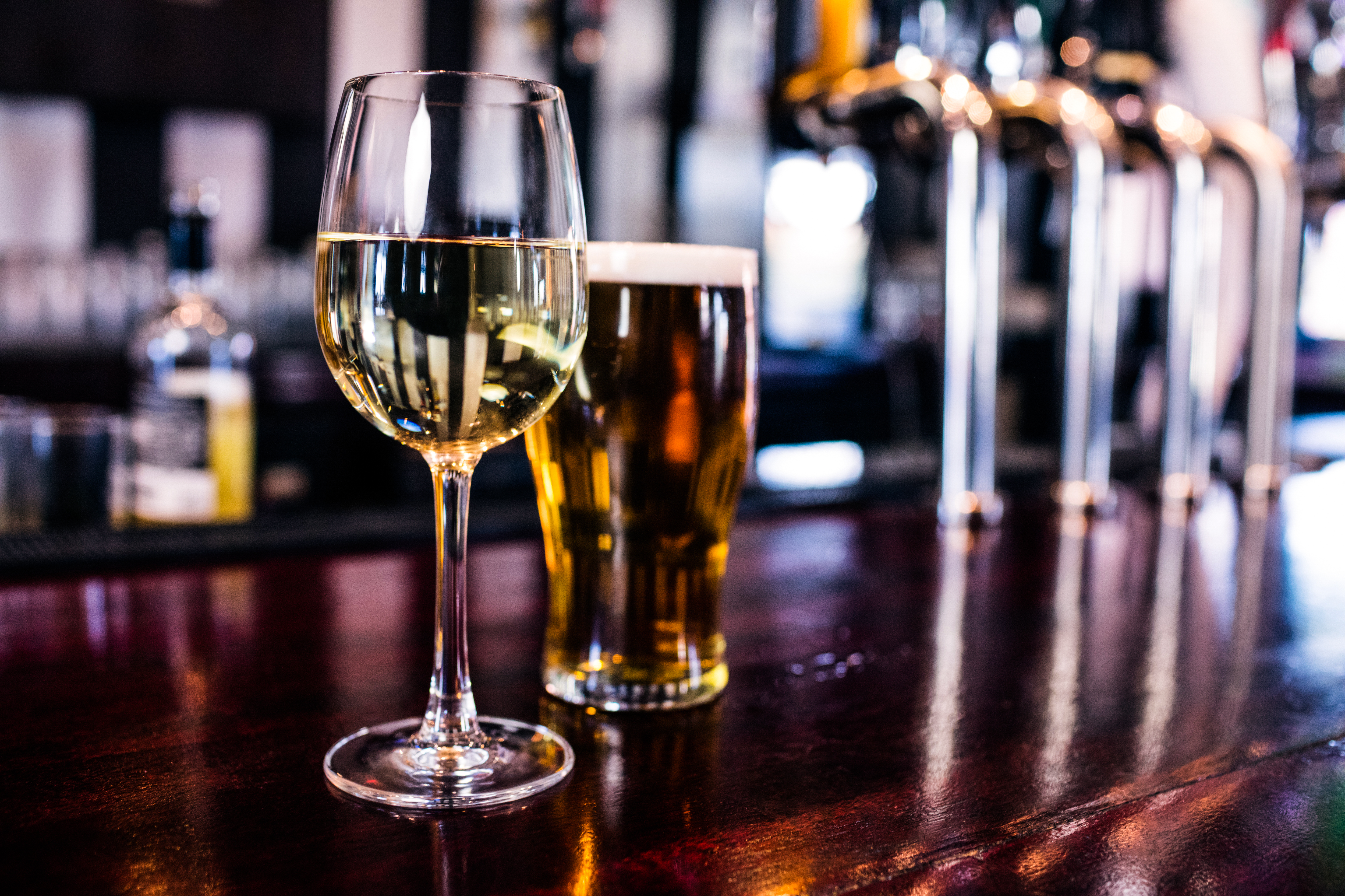 A glass of wine and a glass of beer