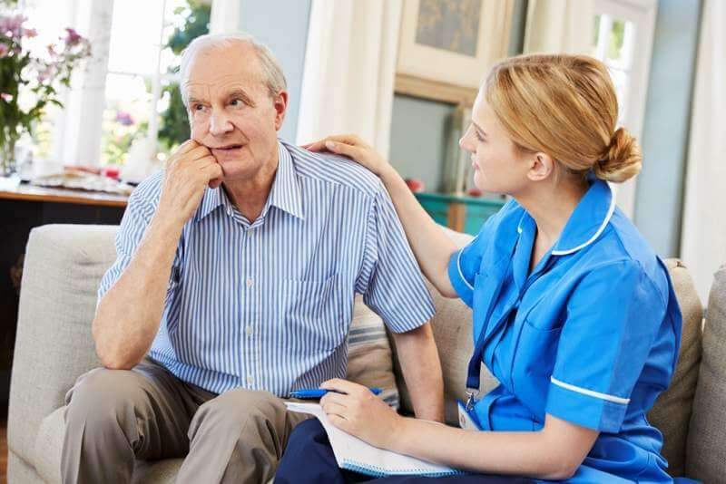 community-nurse-visits-senior-man-suffering