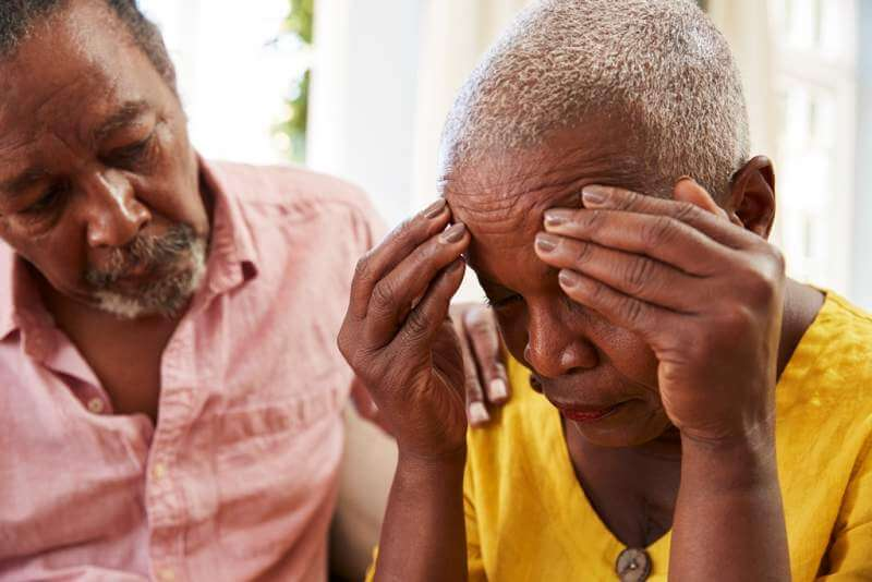 senior-man-comforting-woman-with-depression