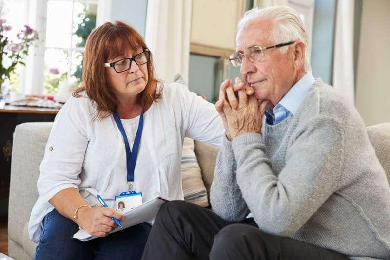 support-worker-visits-senior-man-suffering