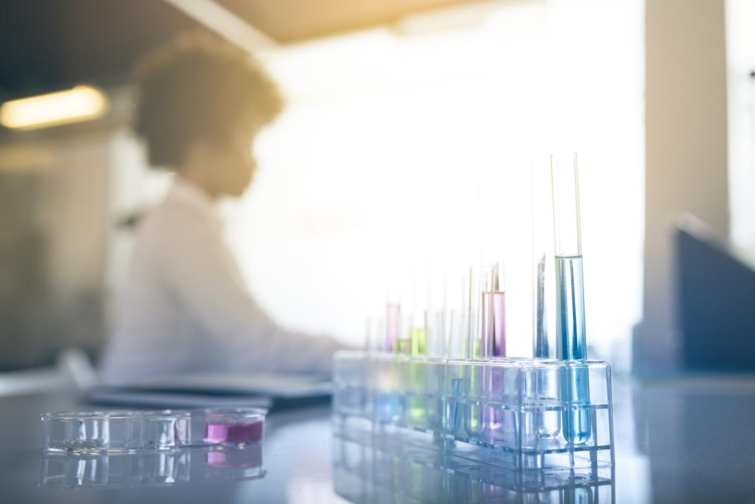 image of blurry scientist in a lab