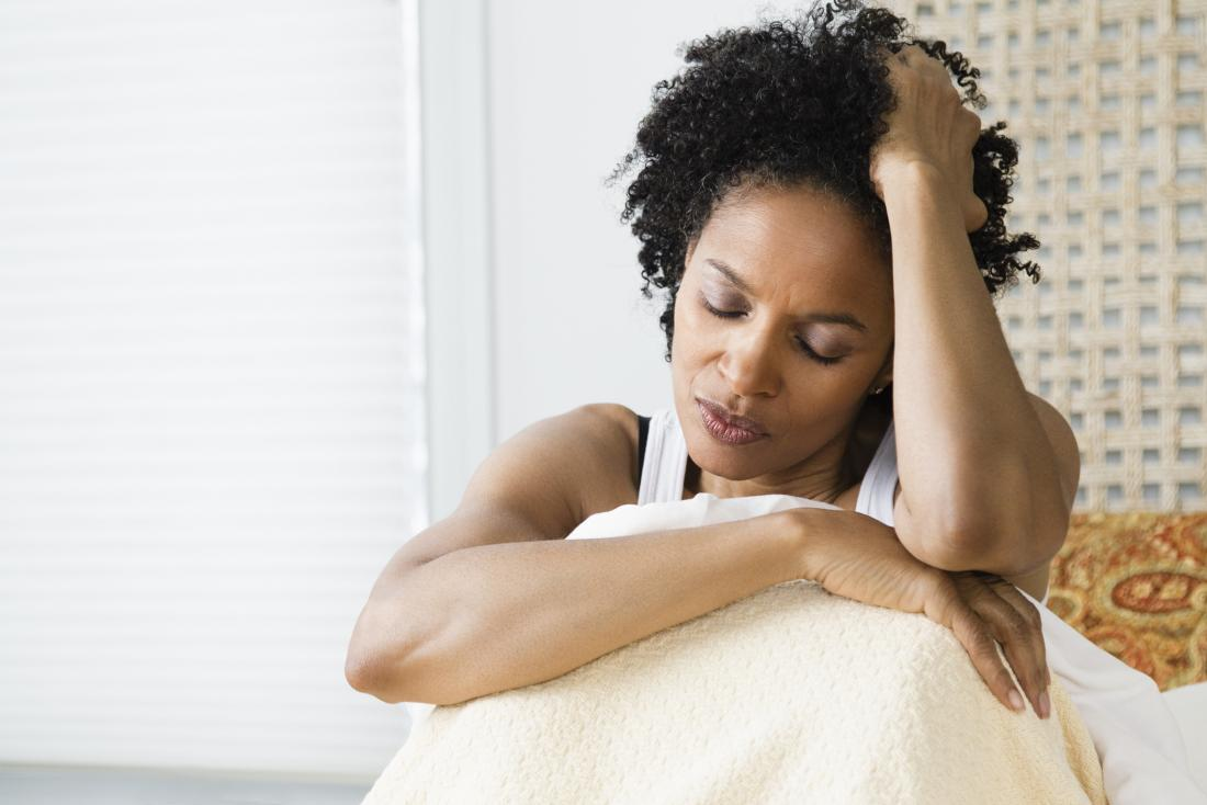 a dissatisfied woman in bed