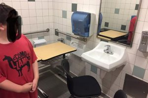 Teacher puts autistic student's desk in a bathroom stall