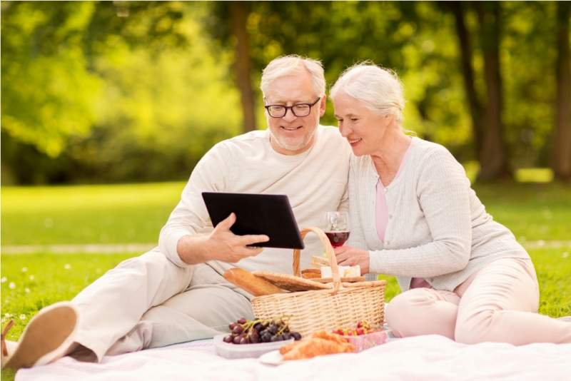 happy-senior-couple-having-picnic-at-summer-park