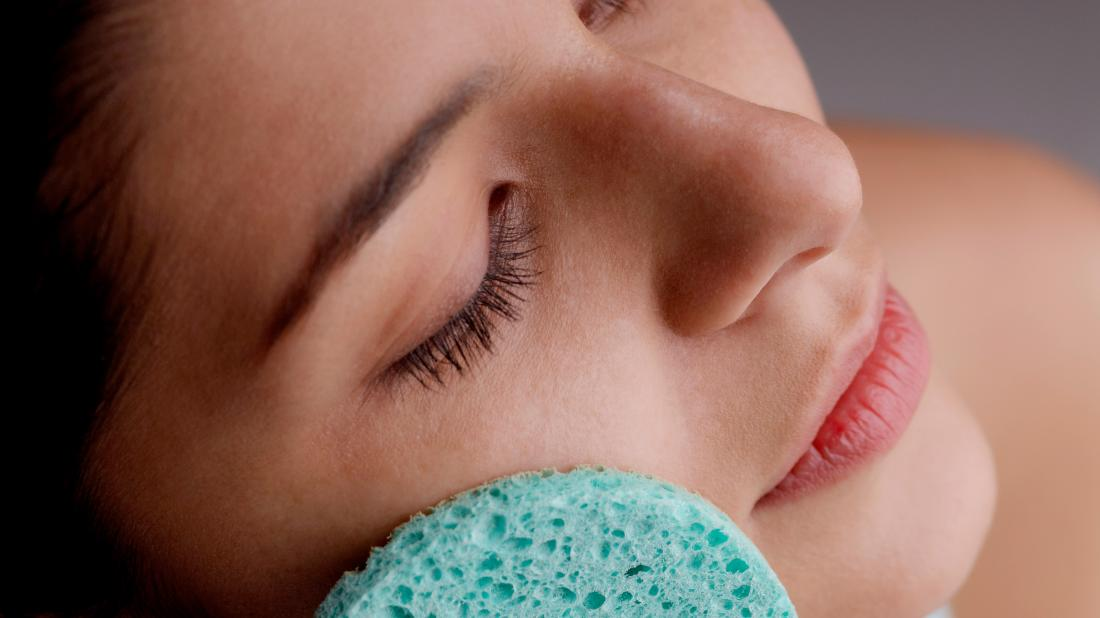 """A person doing exfoliation  on their face with a spong as that is How to remove dead skin from face"""" class=""""css-uoe8zd""""></picture></span><span class="""