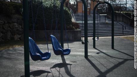 Swings sit empty on Wednesday along North Avenue in New Rochelle, New York.