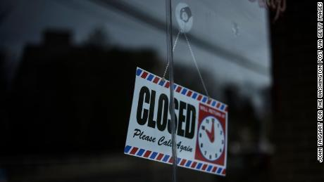A sign in the containment zone in New Rochelle, New York, on Wednesday tells customers the business is closed.