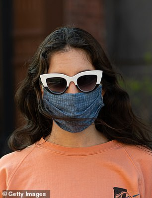 A woman in New York is pictured wearing a makeshift cloth facemask