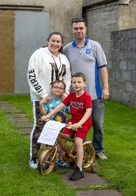 Ryan is pictured with his mum Leanne, dad Donal and brother Lennon.