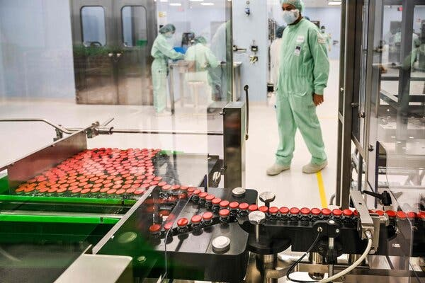 A laboratory technician supervised the production of capped vials at a site in Italy to be used for the Oxford University/AstraZeneca coronavirus vaccine candidate.
